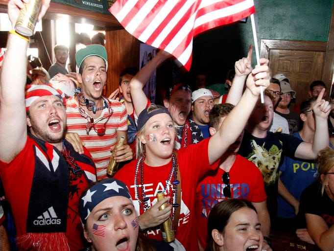 Soccer fans watch the United States men's national soccer team play Belgium in the World Cup at Skinny Slims downtown on Tuesday, July 1, 2014.