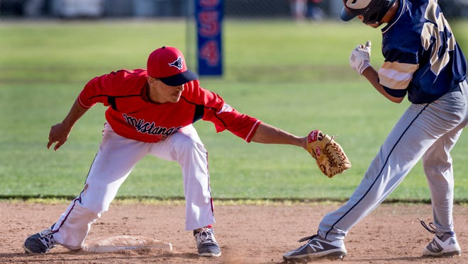 Tulare Western's Ryan Tucker reaches to out Delano's Nathaniel Cardenas at second in an East Yosemite League high school baseball opener on Wednesday, March 14, 2018.