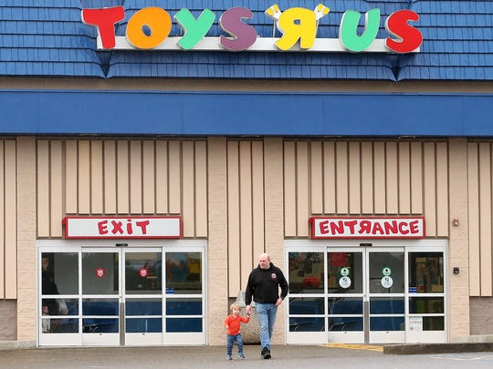 Shoppers exit the Toys R Us store in Silverdale in January 2018. The Brandt family were visiting the store so Zachary's sister could spend some money she got for her birthday. The national retailer announced that month that it would shutter all of its stores.