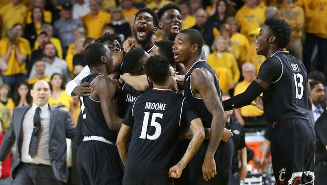 Cincinnati players celebrate after beating Wichita State in the American Athletic Conference tournament Sunday, March 4, 2018, in Wichita, Kan.