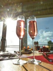 The Surf and Turf, Valentine dessert, and sparkling wine are displayed as part of a Valentine's Day-themed menu at Prego in Tumon on Feb. 7, 2017.