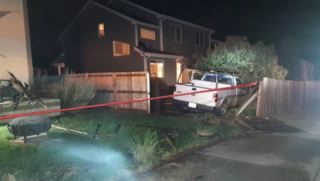 A pickup truck ended up in the back yard of a west Fort Collins residence late Tuesday after striking and downing a light pole and plowing through a fence.