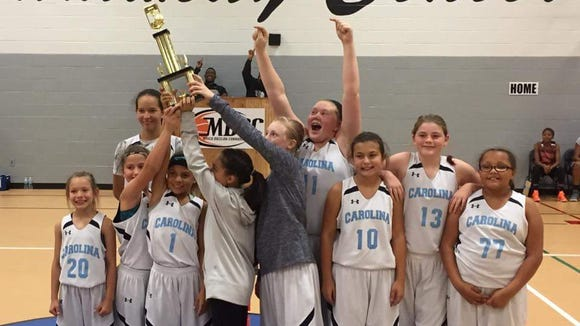 Team Carolina Asheville's 11 and under girls basketball team won the Mid State Fall Final tournament over the weekend in the Burlington area.