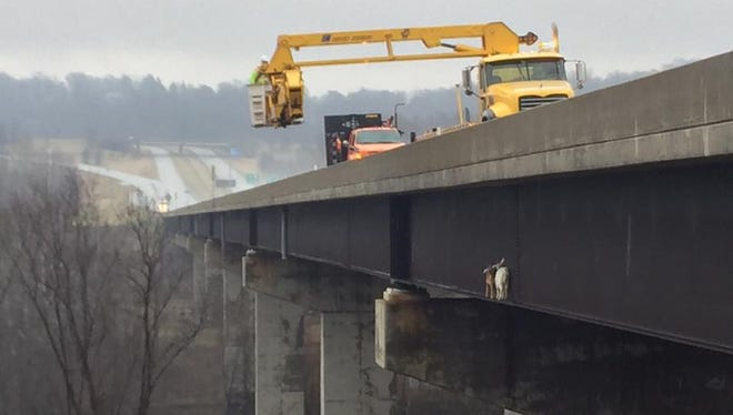 Crews from PennDOT and the Pennsylvania Turnpike save a pair of goats stranded on a beam of the Mahoning River Bridge on Tuesday.