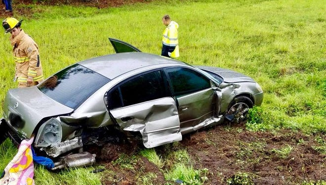 A motorist suffered minor injuries when her car spun out of control on Interstate 95 Saturday in St. Lucie County