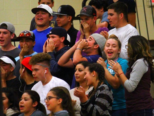The Tularosa student section cheers on their team during the District 4-3A semifinal volleyball match Thursday night.