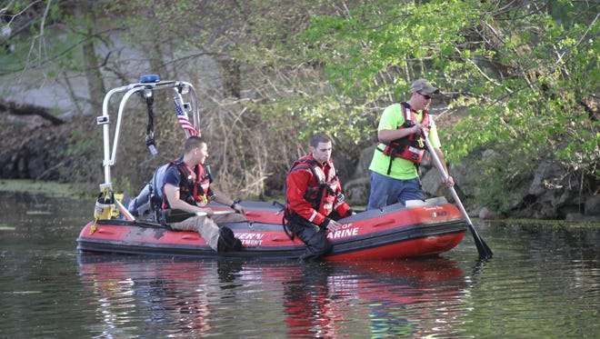 Fire departments from Tallman, Stony Point, Suffern and Mahwah search the ponds on Wesley Chapel Road in Ramapo for Valentina Godin, 77, of Wesley Hills on Friday, April 28, 2017.