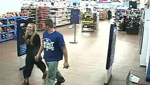 In this January 2015 photo made from surveillance video and released by the Grayson County Sheriff's Office, in Kentucky, 18-year-old Dalton Hayes and 13-year-old Cheyenne Phillips leave a South Carolina Walmart.