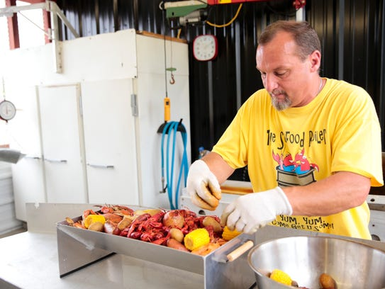 David Duplechin prepares a boiled seafood platter on