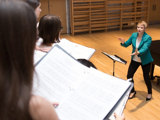 Faculty member Danielle Steele leads choral students at Earlham College's Center for Visual and Performing Arts.