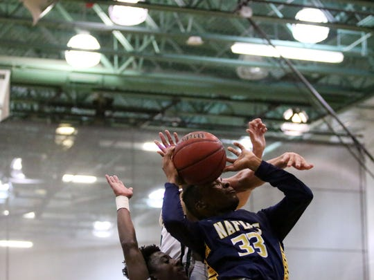 Naples' Sevin Brown attempts to shoot during Tuesday night's game between Naples and Palmetto Ridge.