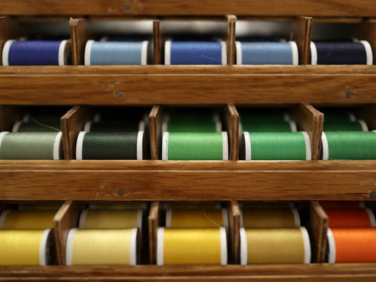 Colored thread displayed at SewNoles, a Midtown sewing