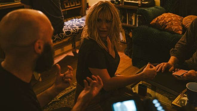 Kesha, center, on the set of 'A Ghost Story' last summer with director David Lowery, left, and magician Jared Kopf, right.
