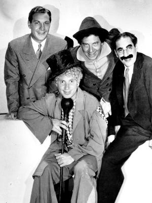 """The Marx Brothers, from left, Zeppo, Harpo, Chico and Groucho on the set of the movie """"Horse Feathers."""""""