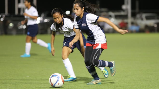 Quality Distributors FC's April Talledo speeds through the midfield during a friendly match against a visiting Northern Mariana Islands team Friday at the Guam Football Association National Training Center. Quality won 2-1.