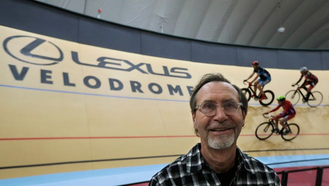 In a photo from Thursday, Jan. 18, 2018, velodrome designer Dale Hughes, who designed and built the Lexus Velodrome, poses with riders on the track in Detroit.