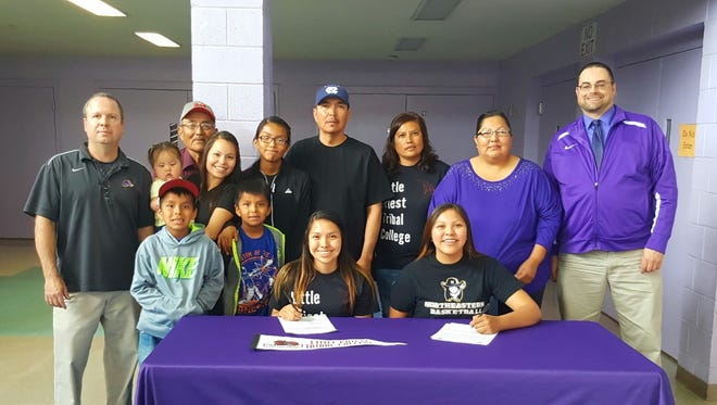 Kirtland Central's Shamika Benally, left, and Krystal Sheka signed letters of intent to play college basketball on Tuesday at Kirtland Central High School.