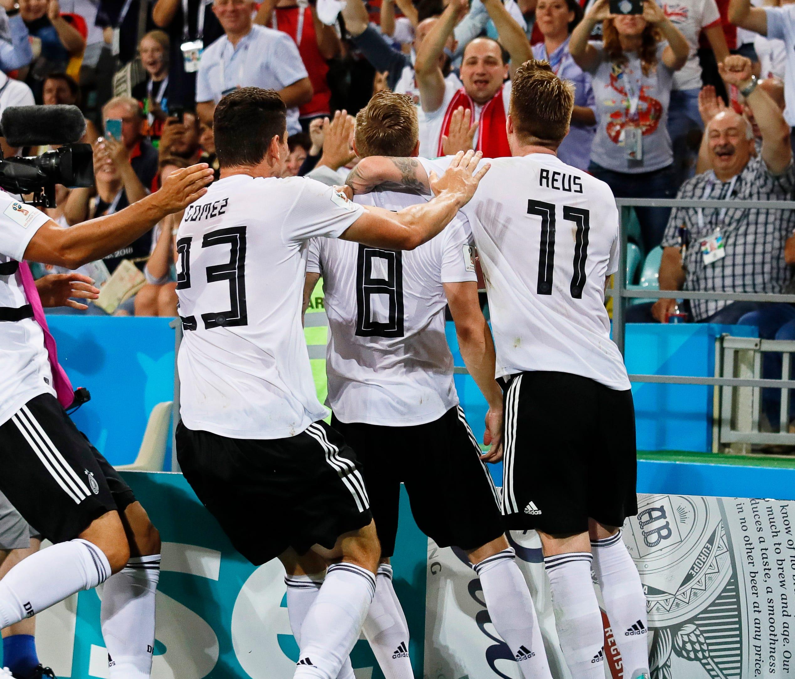 Germany players celebrate Toni Kroos' winning goal.