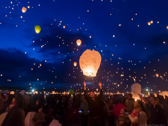 Thousands release decorated hot air lanterns into the