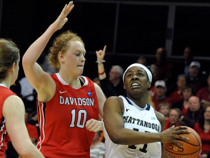Chattanooga's Ka'Vonne Towns heads to the basket past Davidson's Hannah Early.  Chattanooga won the Southern Conference Tournament womens final 71-45 over Davidson. 03/10/14--Bill Sanders
