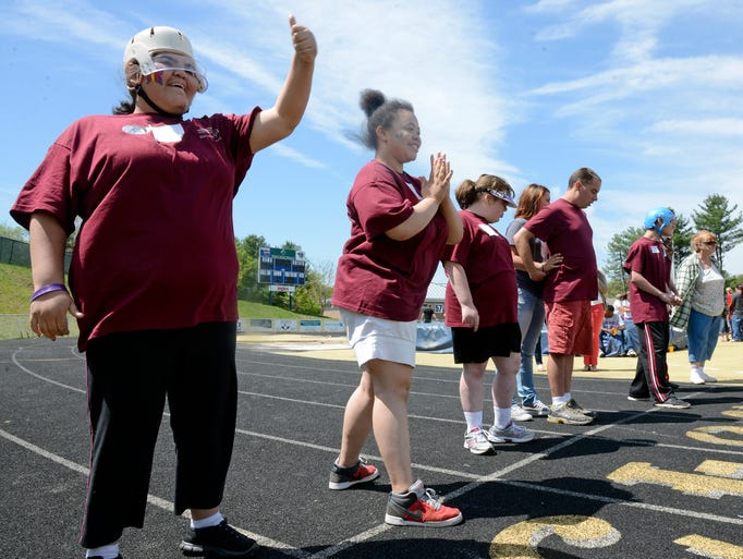 Hundreds of athletes competed in the Special Olympics Spring Games at Roberson High School Thursday. Competitions ranged from the 50 meter dash to the 4x100 meter relay to the long jump and softball throw. 5/1/14. Robert Bradley (rbradley@citizen-times.com)