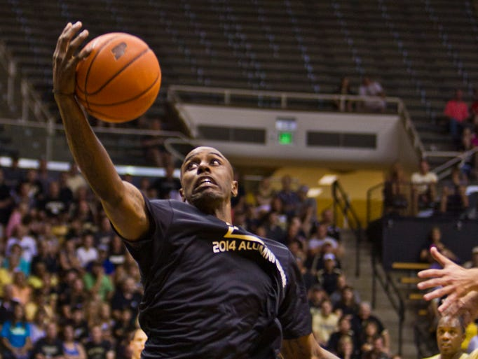 Purdue alumnus Keaton Grant comes down with a pass during the alumni basketball game Saturday, August 2, 2014, at Mackey Arena in West Lafayette.