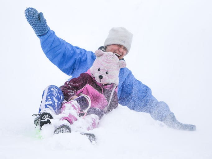 Wednesday February 5th, 2014, Andrea Raes and her daughter Sophia Raes slide down the sledding hill together. Sledders of alleges descend upon the football stadium at Butler University for sledding after a winter storm dumped around 7in on Marion County.