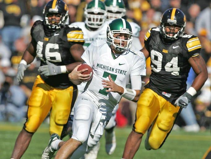 Iowa's Christian Ballard (46) and Adrian Clayborn pursue MSU quarterback Brian Hoyer, as he runs for first down on third down and nine in second quarter.