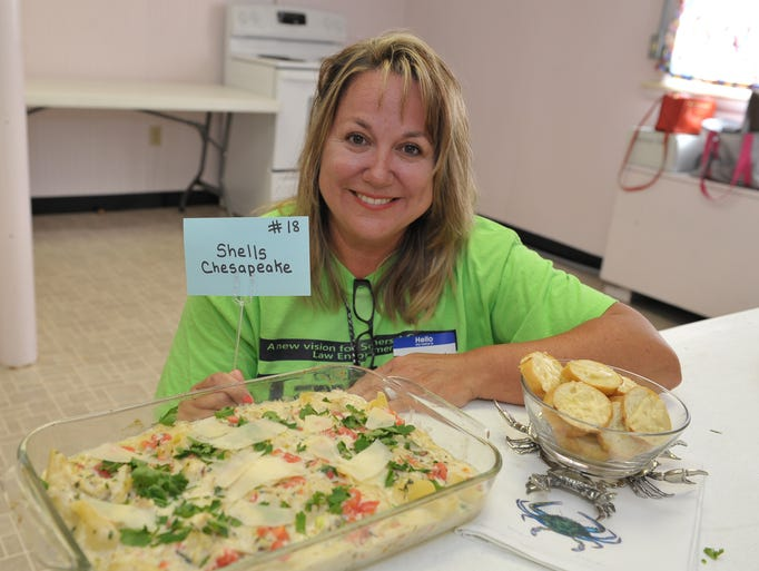 Jeanette Taylor of Princess Anne prepared her Shells Chesapeake dish during the 50th annual Crab Cooking Contest, as part of the 67th National Hard Crab derby in Crisfield.