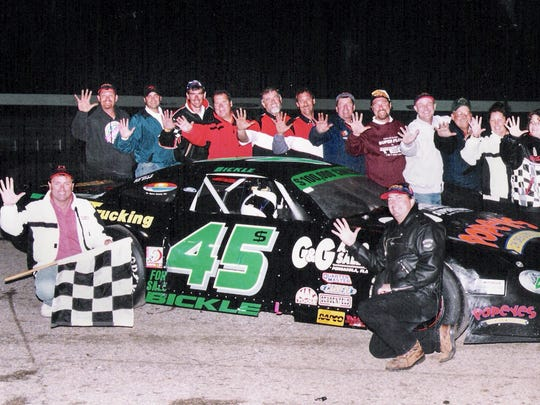 Rich Bickle (lower left) and his team pose for photos