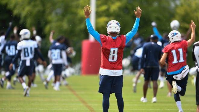 Titans quarterback Marcus Mariota (8) celebrates with teammates as they win a Punt, Pass and Kick competition to end minicamp at Saint Thomas Sports Park on Thursday, June 15, 2017.