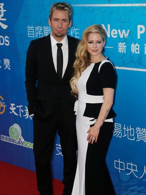 Singer Avril Lavigne and her husband, Chad Kroeger, arrive at the 10th Huading Awards ceremony in Macau, China on Monday, Oct. 7, 2013.