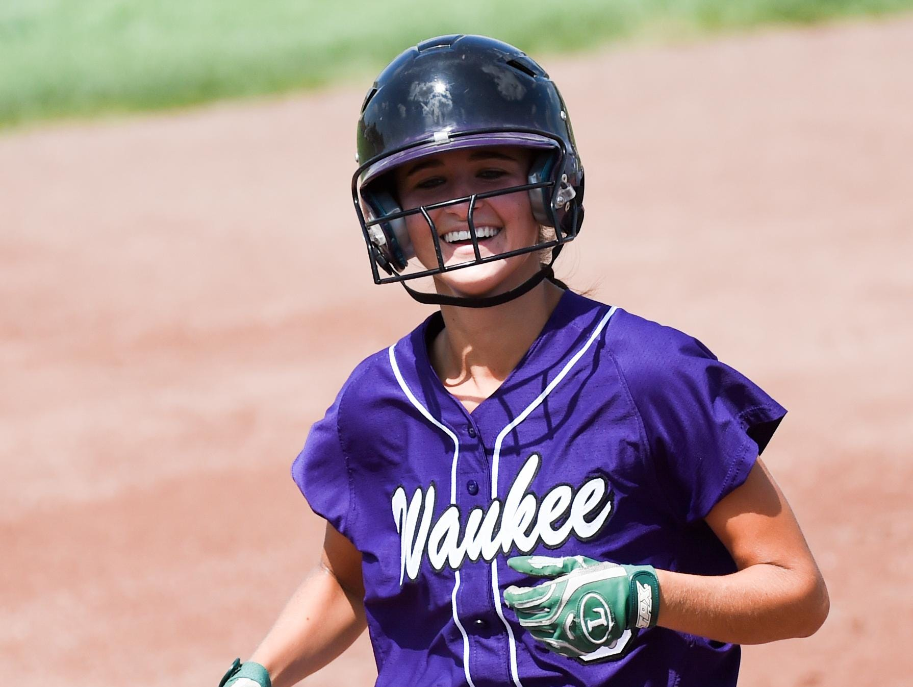 Waukee's Taylor Hulsing (9) smiles as she runs out her two run home run on Thursday, July 23, 2015, during the Class 5-A Semifinals.