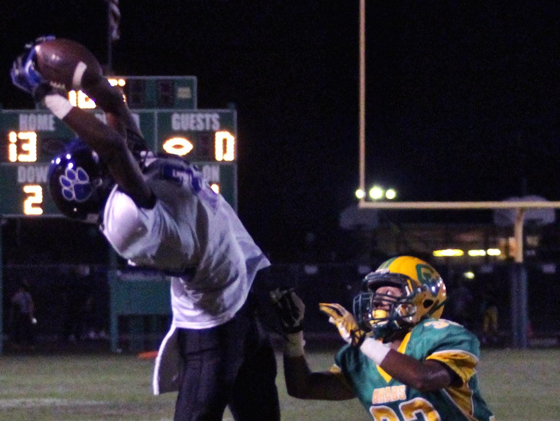 Lions' James Green III (24) catches a pass during an away match with the Arabs on Friday.