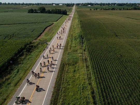 Cyclists make their way out of Keota and onto Wellman