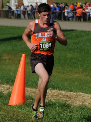Heath's Chandler Wilhelm runs in the state cross country meet Saturday, Nov. 4, 2017, at National Trail Raceway in Hebron.
