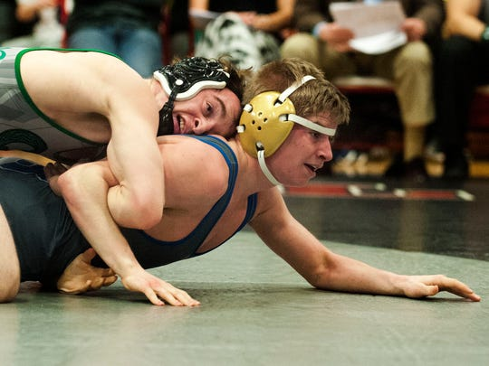 Camden Cathoic's mark McCormick, top, wrestles Northern Burlington's Andrew Smith in the 138 Lb. match during the Region 7 at Robbinsville High School.