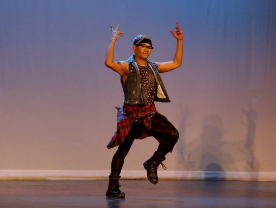 Derek Saelee performs a solo dance routine at the Cascade