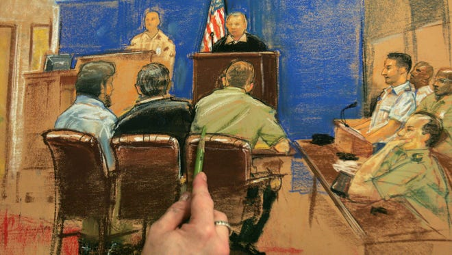 Artist Janet Hamlin finishes a sketch of Guantanamo detainee Abdul Zahir, bottom left, sitting beside his translator and his lawyer Lt. Col. Thomas Bogar during a military tribunal at the U.S. Naval Base in Cuba in 2006. Zahir, whose legal team included attorney David Sleigh of St. Johnsbury, was transferred Tuesday to Oman.