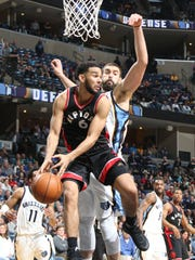 Toronto Raptors Cory Joseph looks to pass defended by Memphis Grizzlies Marc Gasol.