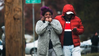 December 7, 2016 - A woman is comforted on Overton Crossing St. following a fatal shooting in the 1900 block of The Oaks Ave. in Frayser on Wednesday. A female victim died at the scene and a male was discovered shot in the leg at the scene. He was transported to the hospital in non-critical condition.