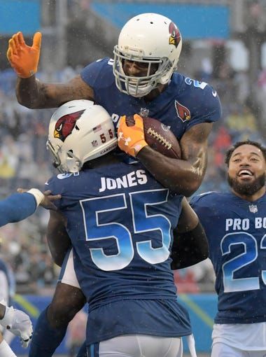 Jan 28, 2018: NFC cornerback Patrick Peterson of the Arizona Cardinals (21) celebrates with Ccardinals inebacker Chandler Jones (55) and cornerback Marshon Lattimore of the New Orleans Saints (23) after intercepting a pass in the 2018 NFL Pro Bowl at Camping World Stadium. The AFC defeated the NFC 24-23.