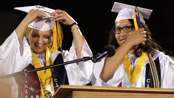 Senior valedictorians Amanda Borden, left, and Yarely Ogaz led the Deming High School Class of 2016 in the turning of the tassels during Friday's commencement exercise at DHS Memorial Stadium.