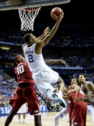 Aaron Harrison #2 of the Kentucky Wildcats goes to the basket as Bobby Portis #10 of the Arkansas Razorbacks defends during the SEC tournament championship.