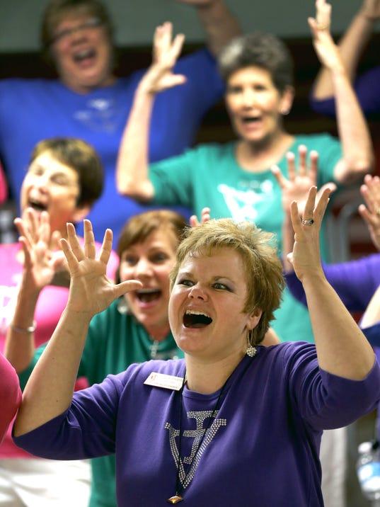 Fox Valley Chorus member Brenda Krueger, front, of Neenah, sings ...