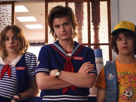"Maya Hawke, Joe Keery, Gaten Matarazzo in a scene from season 3 of the Netflix series ""Stranger Things"""