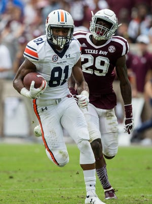 Auburn wide receiver Darius Slayton (81) out runs Texas A&M defensive back Debione Renfro (29) for a touchdown after a long catch during the first half of an NCAA college football game on Saturday, Nov. 4, 2017, in College Station, Texas. (AP Photo/Sam Craft)