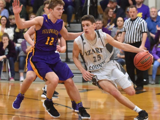 Izard County's Caleb Faulkner is defended by Bay's