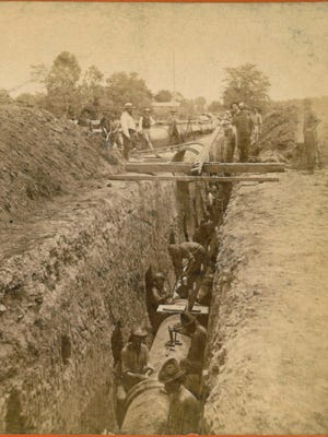 Laying pipe circa 1878-79 in the vicinity of Frankfort and Brownsboro avenues.