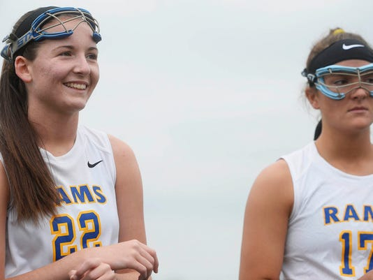 """Kennard-Dale's Morgan Day, left, and Lyndsey Duty during the coaches and captains meeting before the District 3 3rd place game against Susquehannock at Lower Dauphin Middle School in Hummelstown Thursday, May 21, 2015. Day broke the national scoring record in high school girls' lacrosse during the game, helping her team beat Susquehannock 15-11.  Kate Penn â """" Daily Record/Sunday News"""